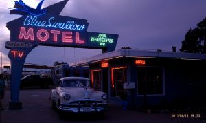 Blue Swallow Motel neon sign and classic car.