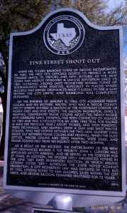Historic marker for the Pine Street Shoot Out.