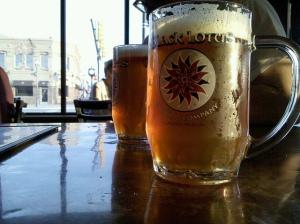 Mugs of beer on the bar.
