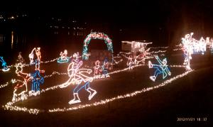 Ice skaters in lights.
