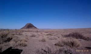 View Huerfano Butte just beyond the historic marker.
