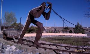 This sculpture about mining stands tall and long.