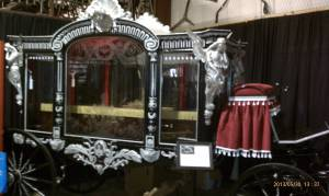 An elaborate horse drawn hearse.