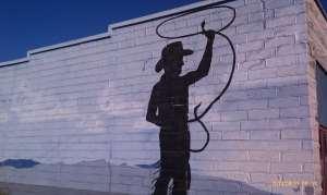 Pecos Bill swinging a rattlesnake lasso.