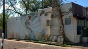 The mural blends in with the foliage behind.