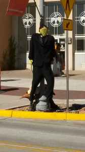 During Halloween there are scarecrows lining the street.