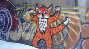 A fox prepares to battle a bear.