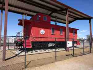 A classic red caboose on display.